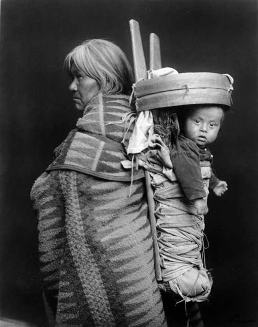 Navajo woman and child in cradleboard